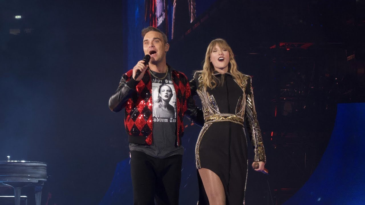 "DUETOS FANTÁSTICOS: ROBBIE WILLIAMS E TAYLOR SWIFT INTERPRETAM ""ANGELS"""
